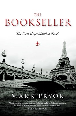balck and white book cover with Paris elaborate bridge over the Seine in the foreground and Eifel Tower in the background