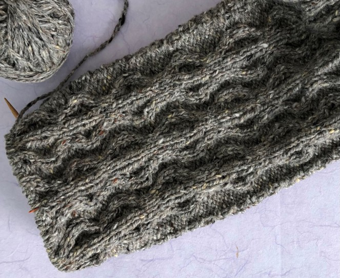 knit sleeve with cables still on knitting needles