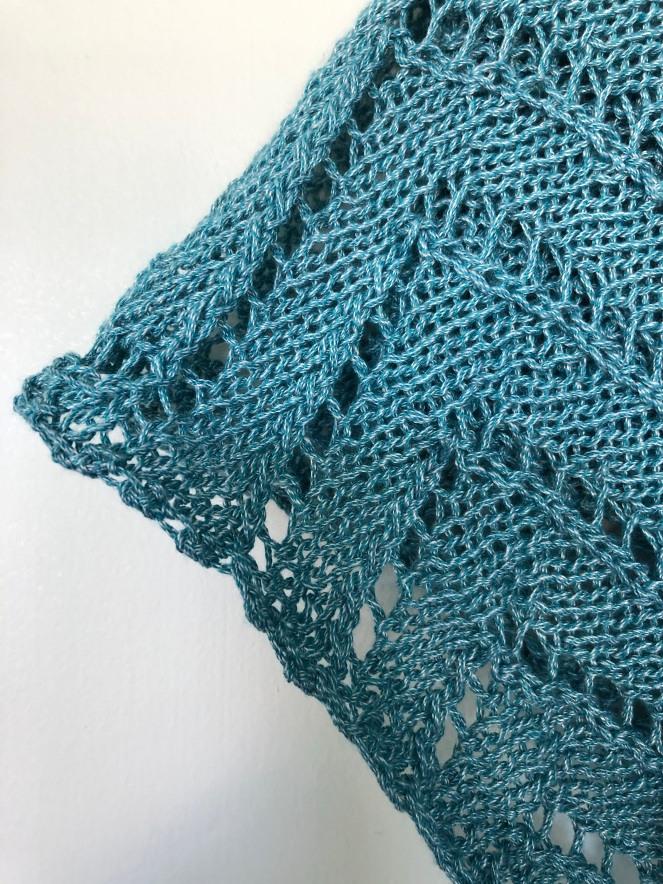 light teal knitted lace work
